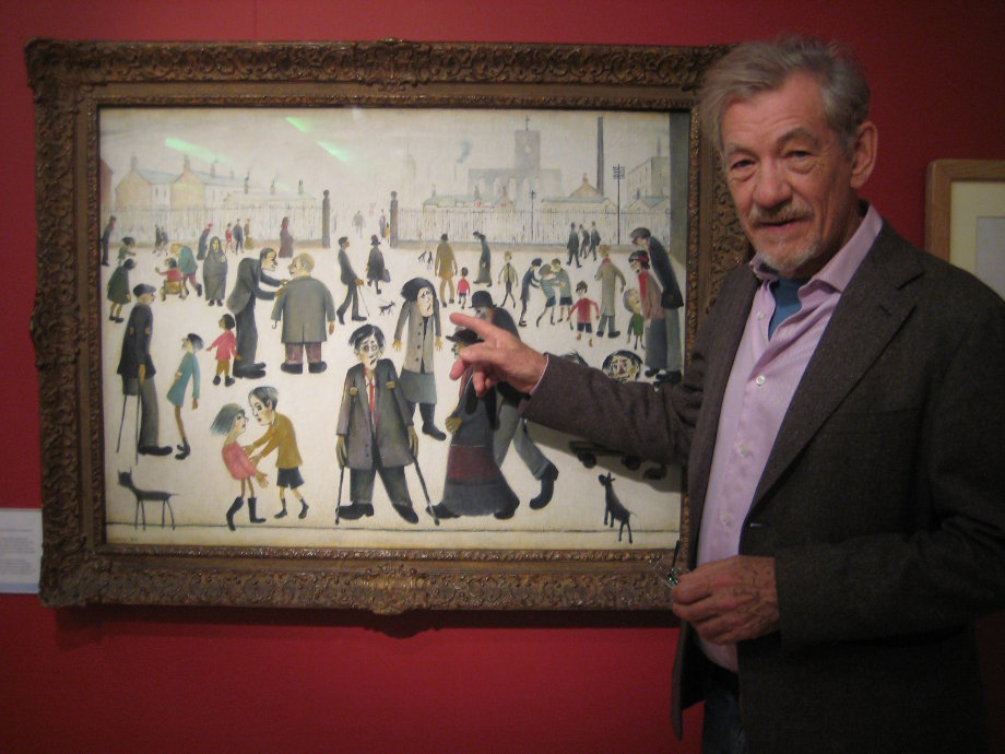 Ian McKellen with Lowry painting The Cripples