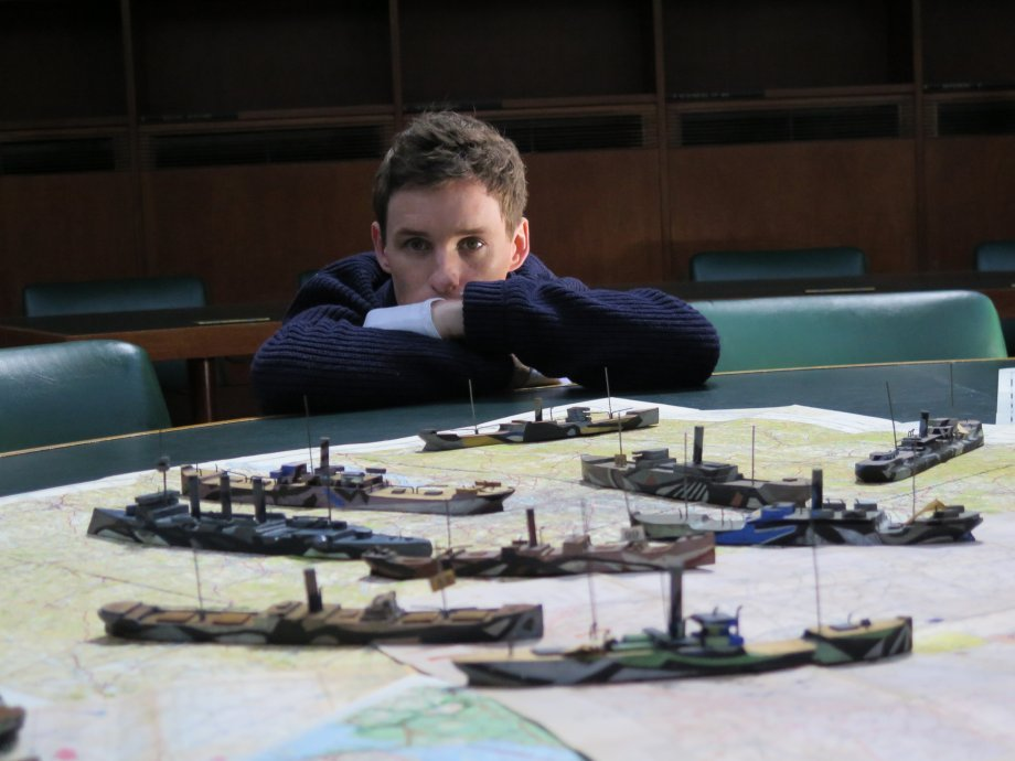 Eddie Redmayne with dazzle ship models at the IWM.  Photograph © www.foxtrotfilms.com